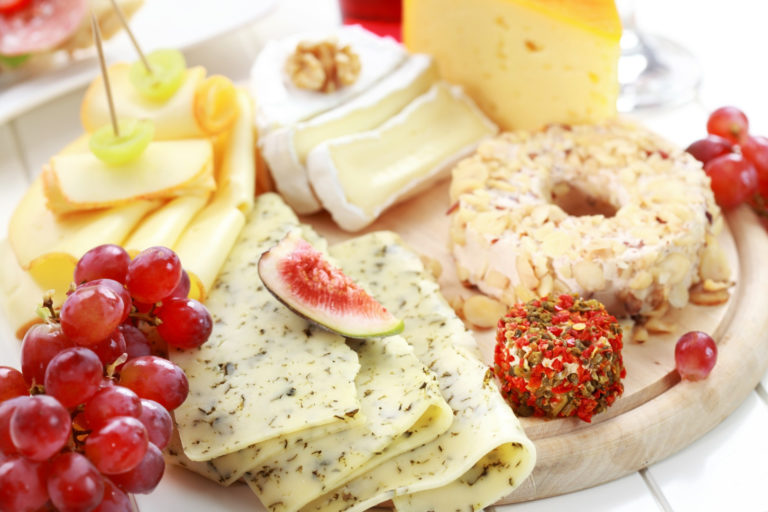 Catering cheese platter with fruits